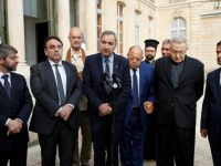 (L-R) France's Chief Rabbi Haim Korsia, French Jewish central Consistory President Joel Mergui, Wang-Genh, President of the Buddhist Union of France, President of Protestant Federation of France Pastor Francois Clavairoly, Paris Mosque rector Dalil Boubakeur, Grigorios Ioannidis General Vicar of the Greek Orthodox metropolis, French Cardinal Andre Vingt-Trois, and Ahmet Ogras, vice-president of the French Council of The Muslim Faith, speak to journalitsts after a meeting with the French President and representatives of religious communities at the Elysee Palace in Paris, France, a day after a priest was killed with a knife and another hostage seriously wounded in an attack on a church in Saint-Etienne-du-Rouvray carried out by assailants linked to Islamic State, July 27, 2016.  REUTERS/Benoit Tessier